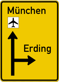 The advance notice sign indicates the direction as well as the number of lanes in each direction.